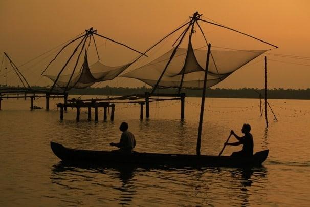 Local men rowing a country boat, near Kumbalangi, Cochin