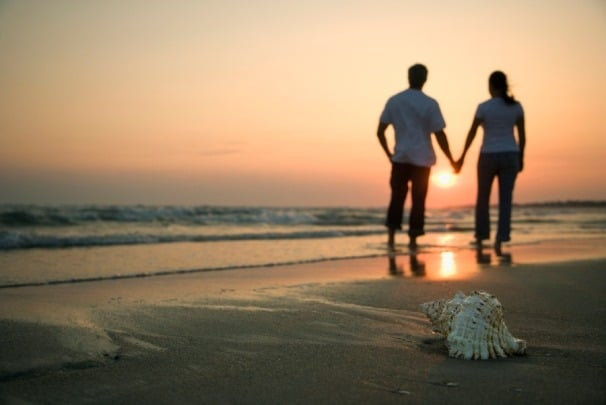 Couple holding hands...walking along the beach!