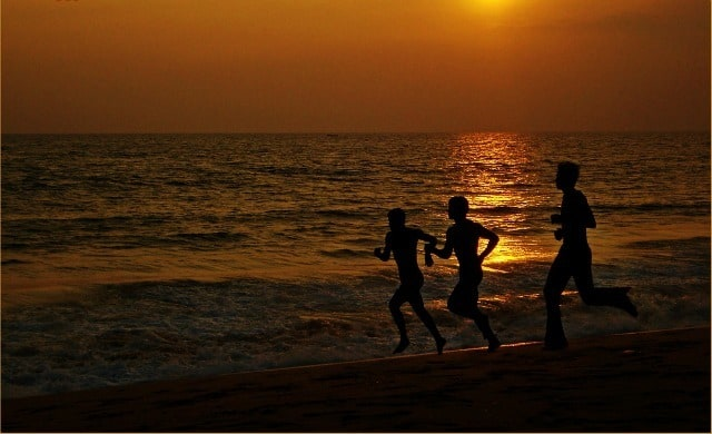 Running along the sea shore