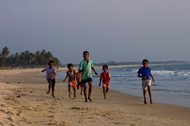 Children Running Along the Kappad Beach