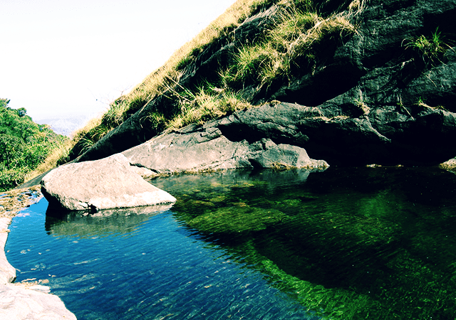 Shallow Water Pool on Top of Olichuchattam Falls