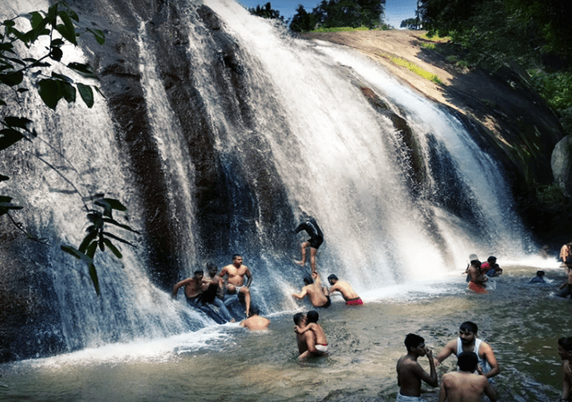 Tourist Enjoying the Waterfall